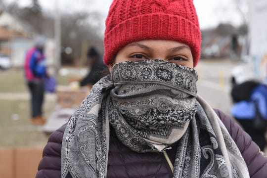 Raquel Wardlow of Detroit braves the cold wind walking along W. Chicago Street as low temperatures hit the Metro Detroit area on Feb. 8, 2019.