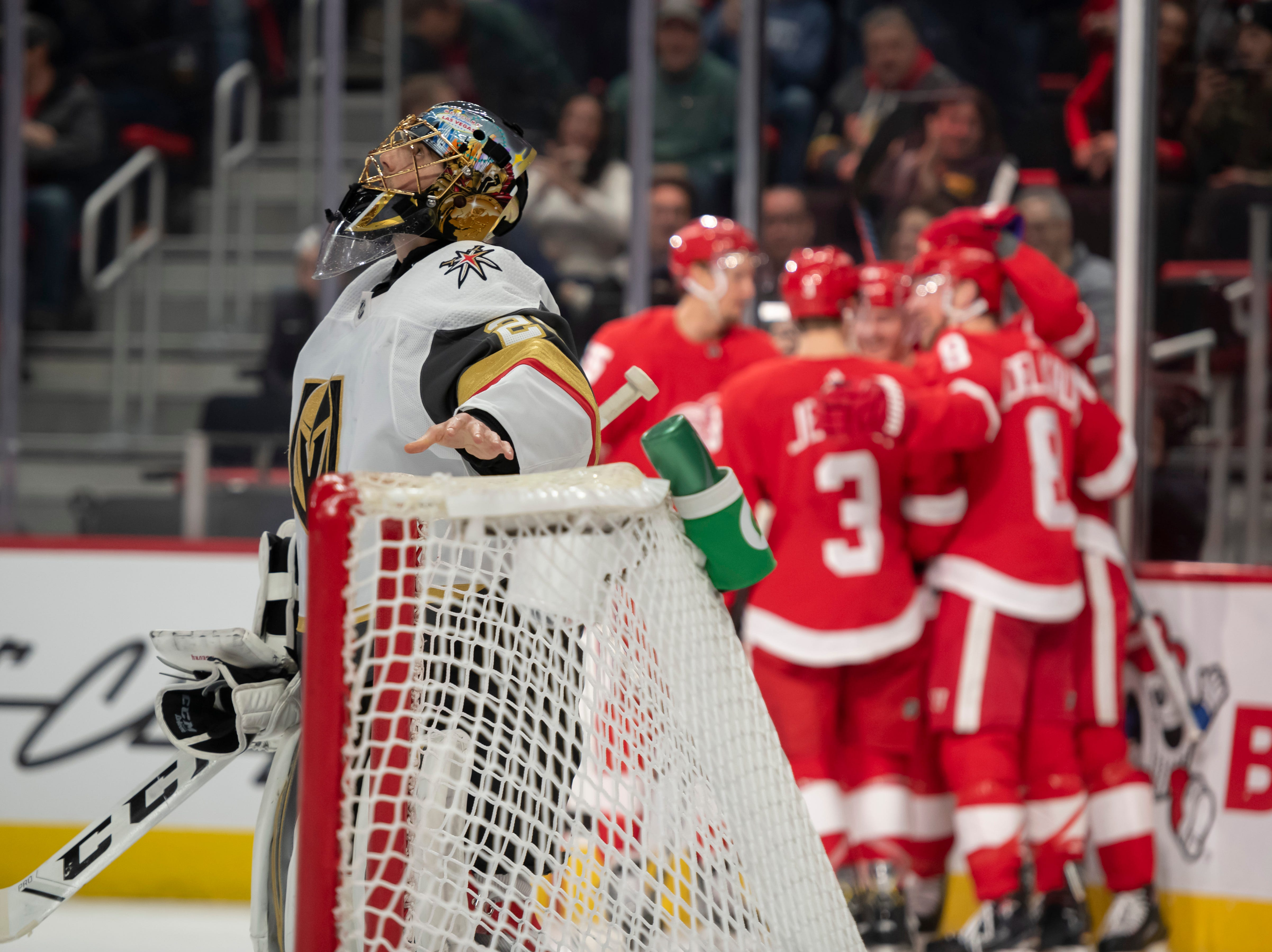 Vegas goaltender Marc-Andre Fleury looks away as Detroit celebrates a goal by center Gustav Nyquist in the first period.