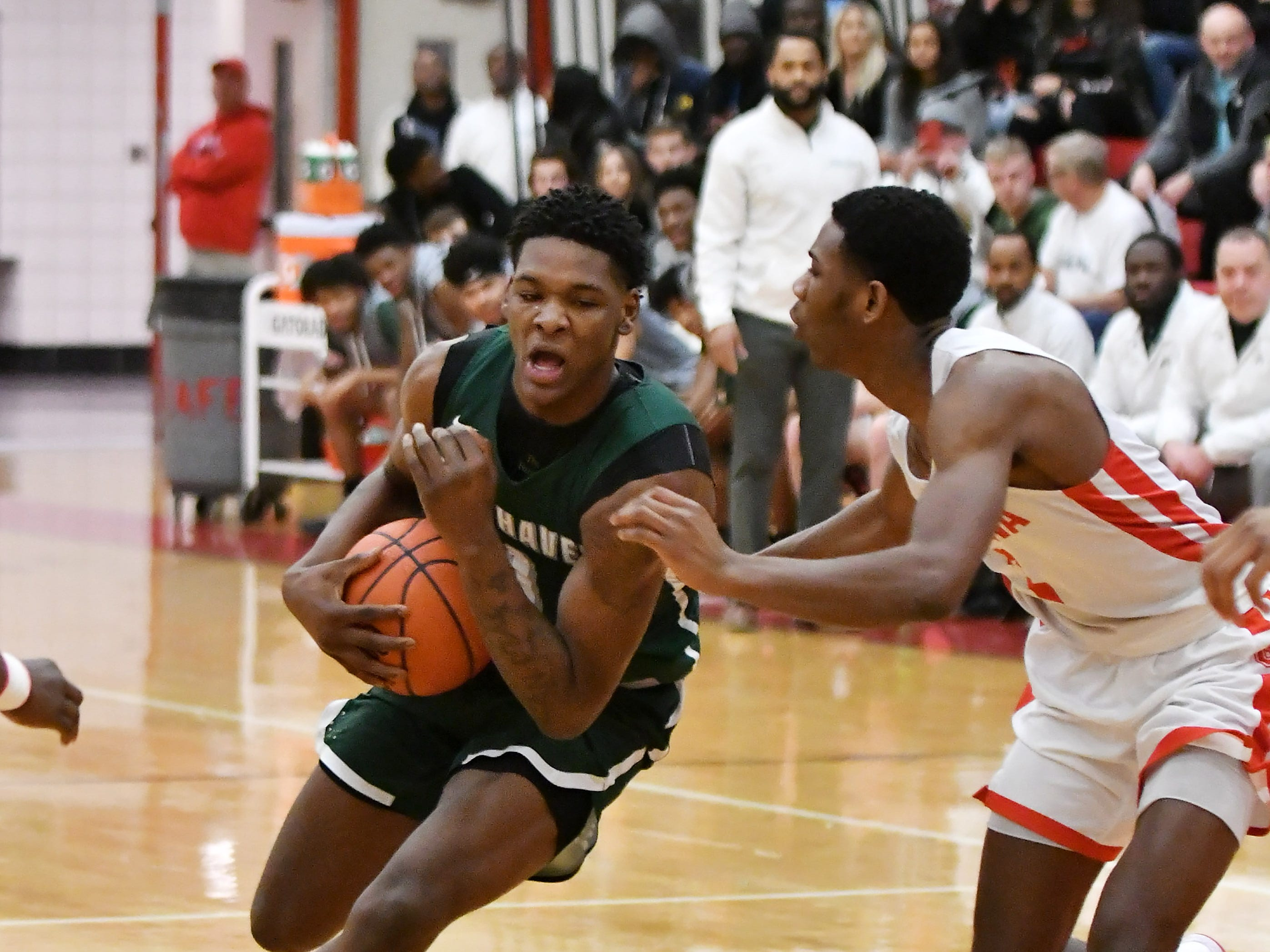 Chippewa Valley's Corey McCray, right, guards New Haven's Romeo Weems in the first half.