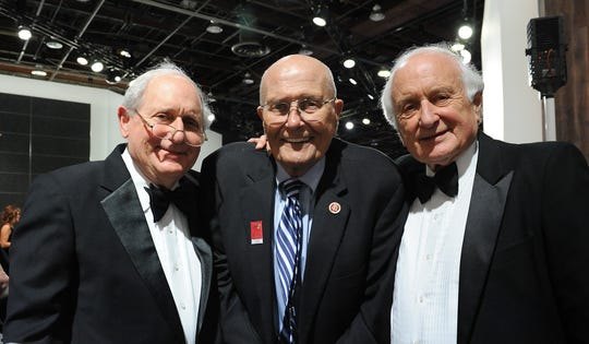 From left, U.S. Sen. Carl Levin, D-Detroit, U.S. Rep. John Dingell, D-Dearborn, and U.S. Rep. Sander Levin, D-Royal Oak pose for a photo at the Charity Preview for the 2013 North American International Auto Show at Cobo Center.