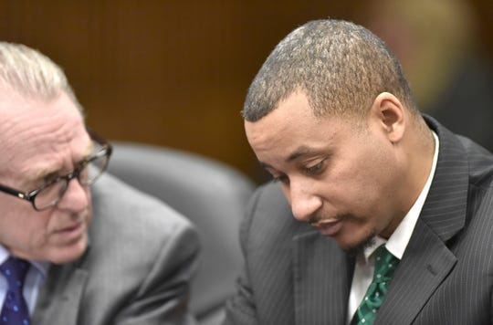 Former state Senator Virgil Smith, right, listens to his defense attorney, David Steingold, Friday in court.