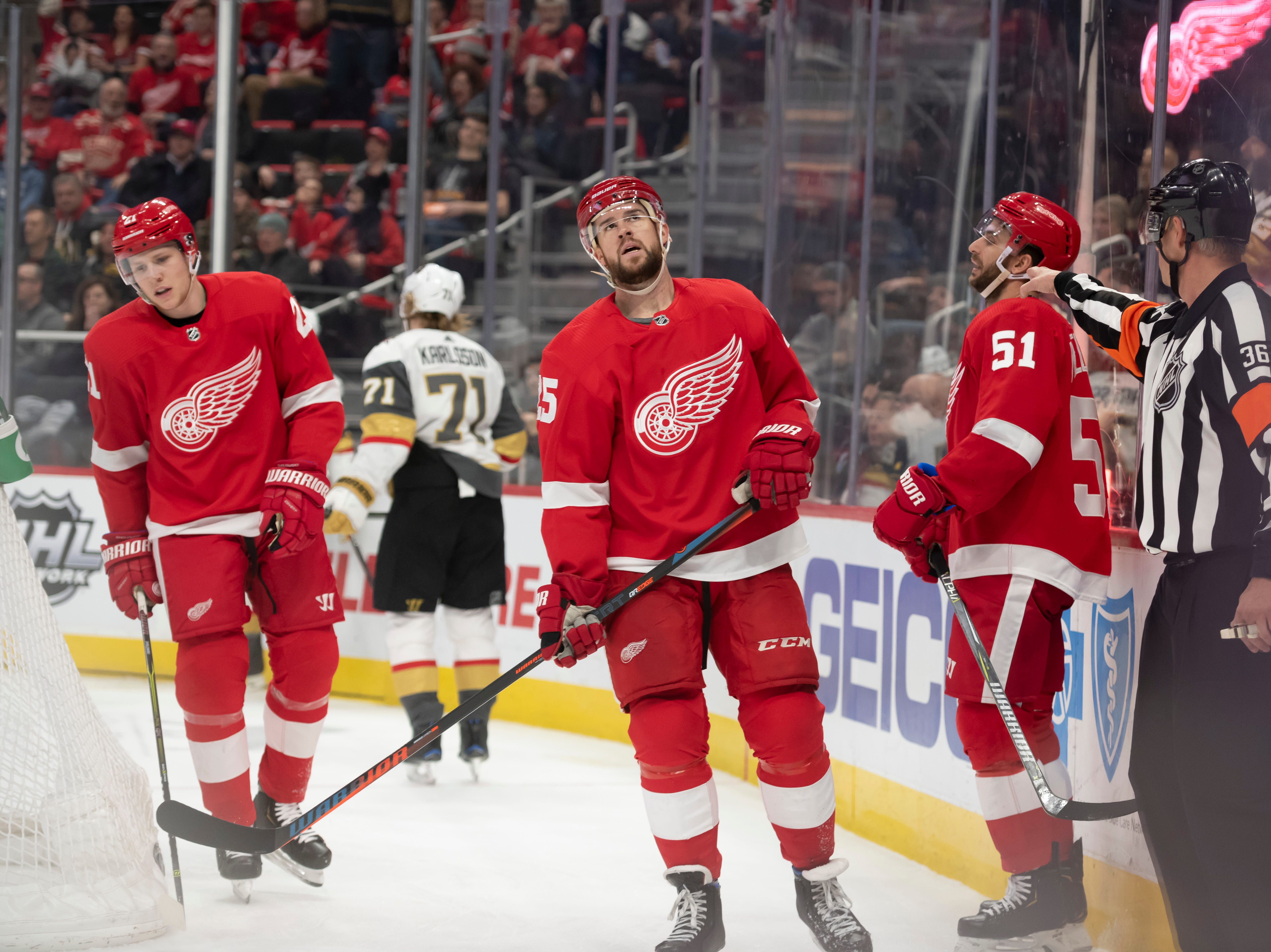 Detroit's defenseman Dennis Cholowski, defenseman Mike Green, and center Frans Nielsen react as referee Dean Morton signals for a goal by Vegas center William Karlsson in the second period.