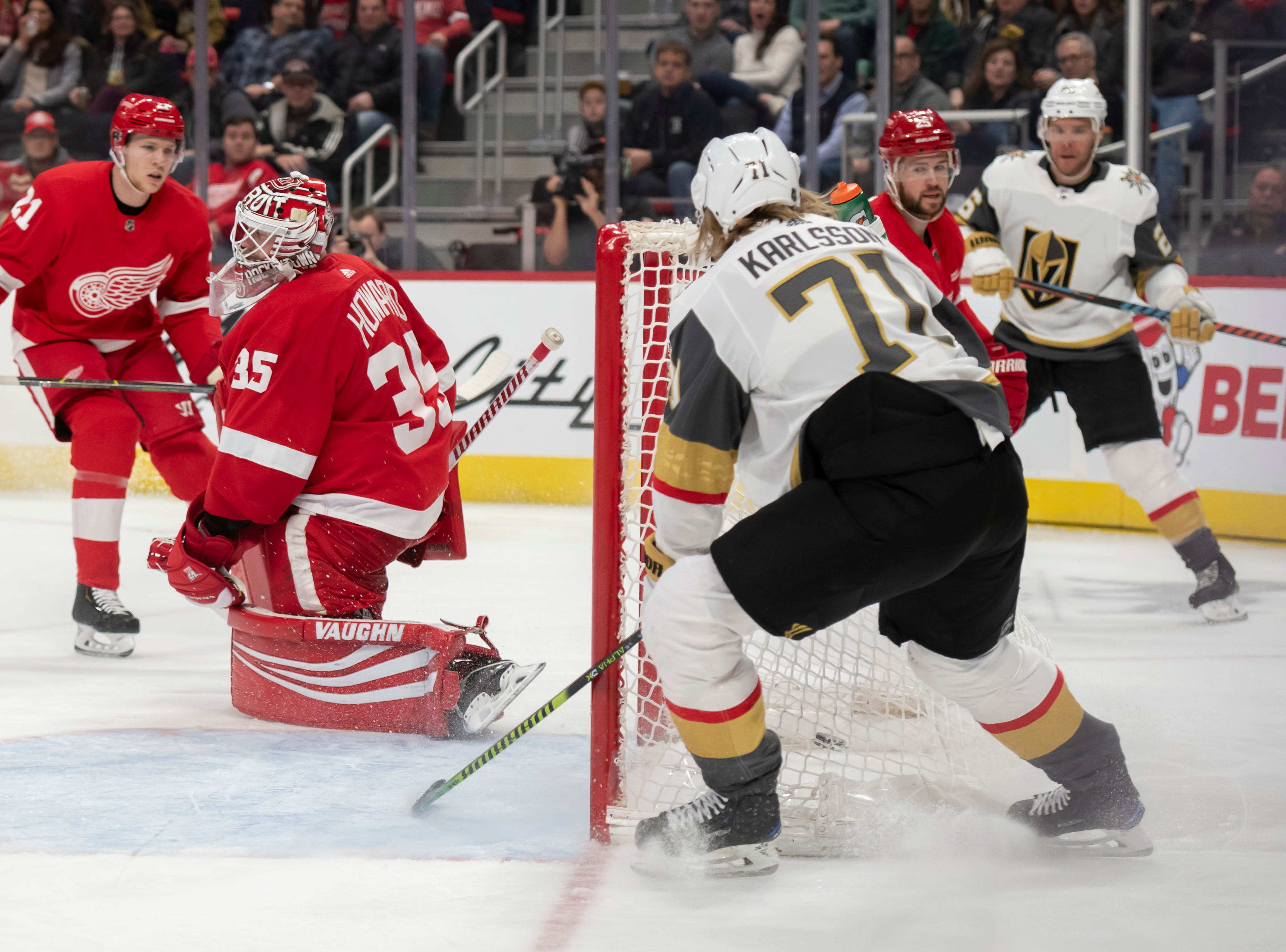 Vegas center William Karlsson slips the puck past Detroit goaltender Jimmy Howard for a goal in the second period.