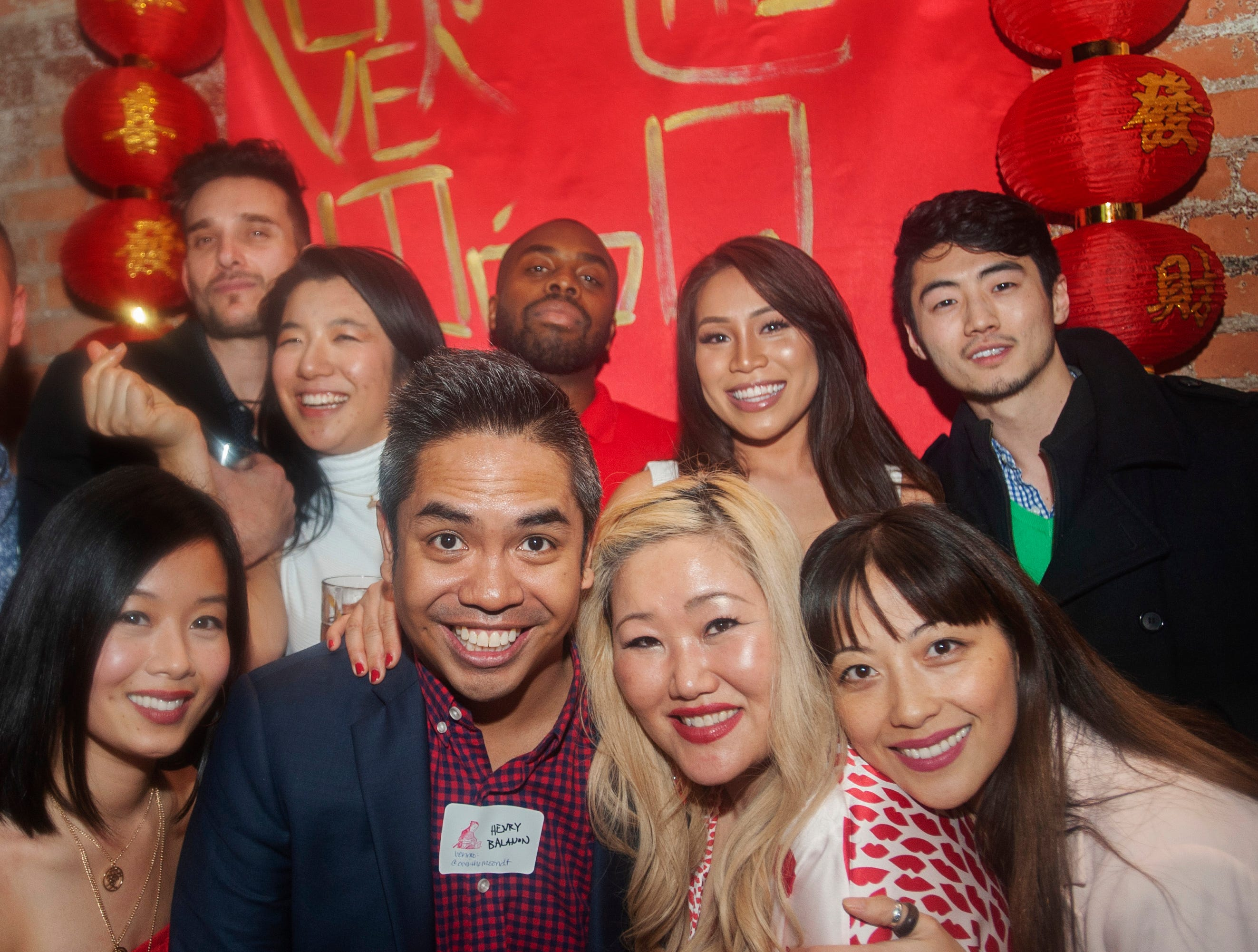 Over the Moon party organizers and attendees, including (from row, from left) Jennifer Vuong, Henry Balanon, Esther Kim, Gowhnou Lee and (backrow from left) Joy Wang, Medvis Jackson, Michelle Nguyen and Stephen Oh, celebrate the Lunar New Year with an east-Asian style party at Detroit City Distillery in Eastern Market on Thursday, February 7, 2019.
