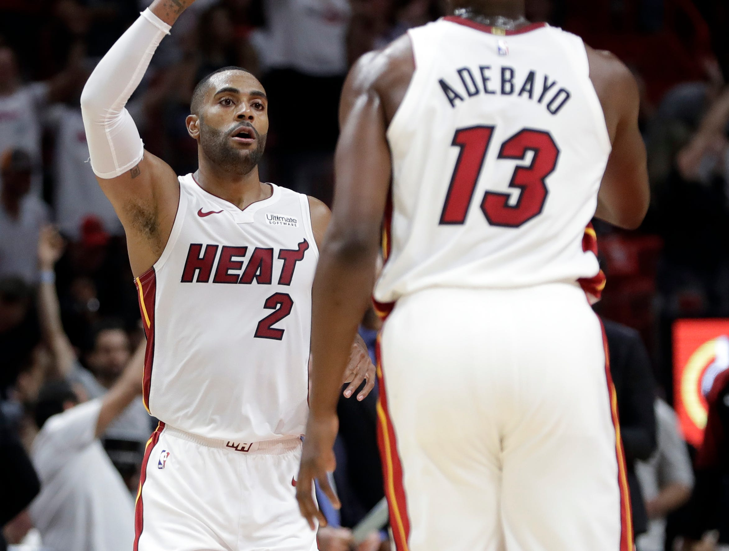 Miami Heat guard Wayne Ellington reacts after shooting a 3-point basket during the second half of an NBA basketball game against the San Antonio Spurs, Wednesday, Nov. 7, 2018, in Miami.
