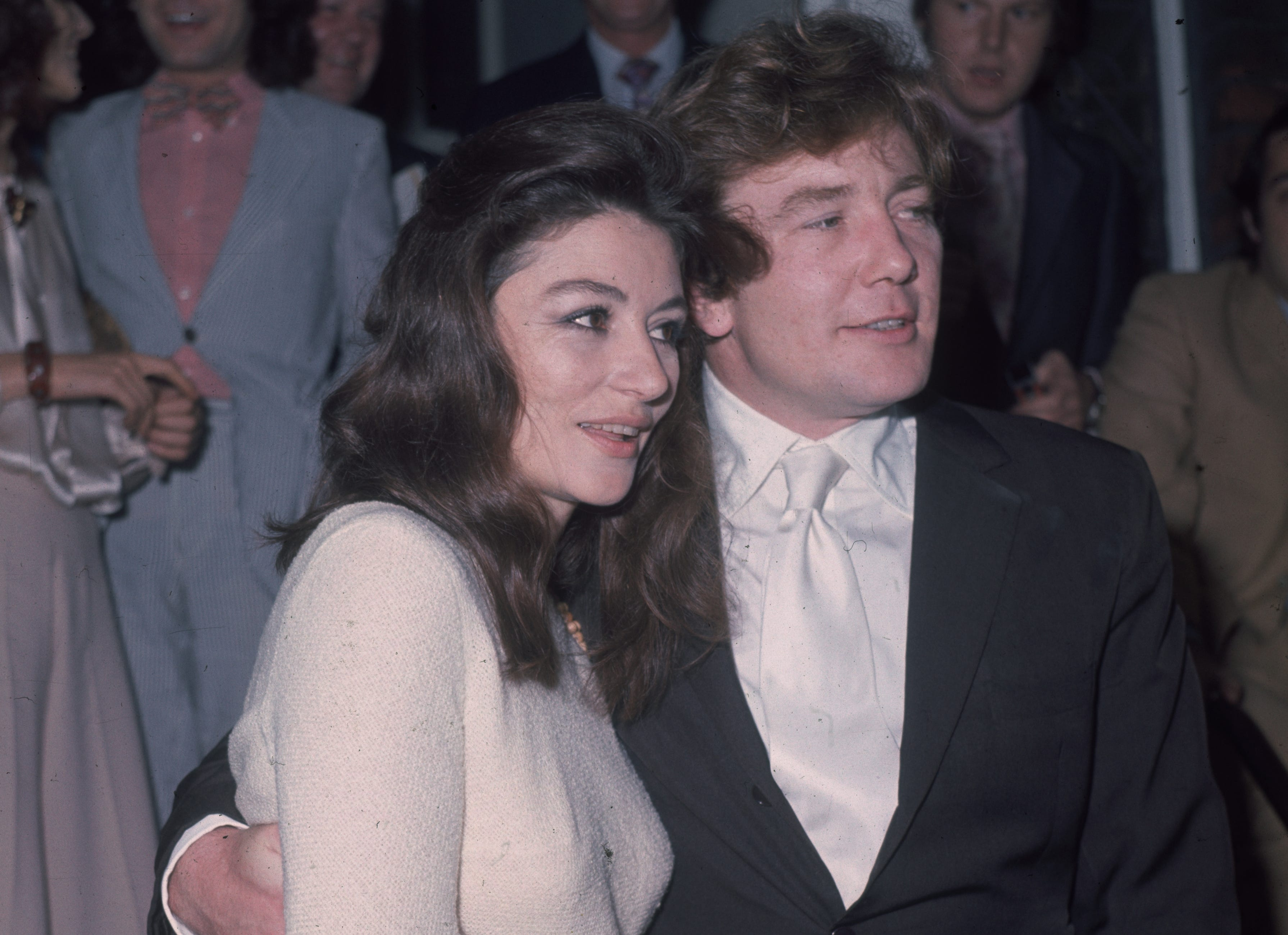 1970:  Actor Albert Finney with his arm round his bride, French film actress Anouk Aimee (born Nicole Fran-oise Dreyfus).