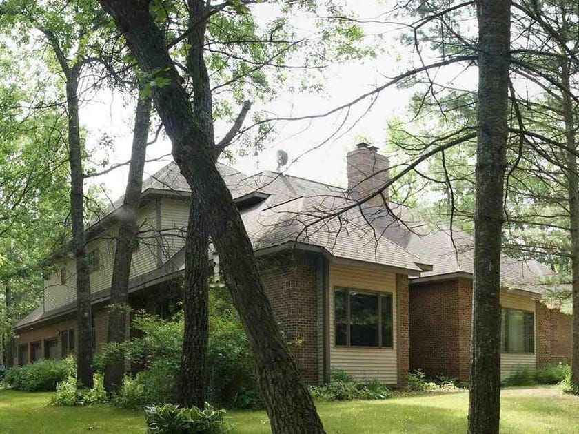 This custom-built home is surrounded by 15 acres of private woods near Tawas City. It is listed for sale for $499,900.