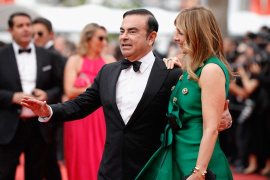 Renault CEO Carlos Ghosn and his wife Carole Ghosn, seen at the Cannes Film Festival in France on May 26, 2017, rented the Chateau de Versailles for their Marie Antoinette-themed wedding party in 2016.