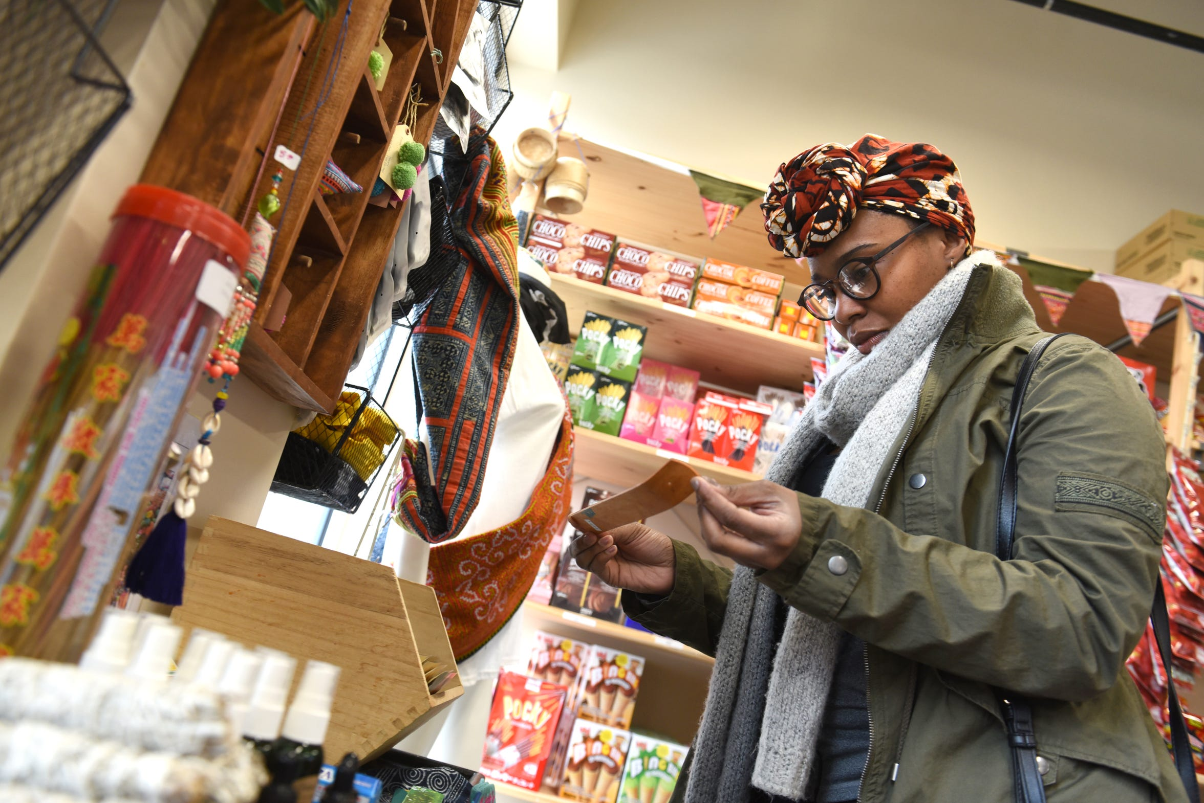 Linda Watson of Detroit shops inside of Tou & Mai, a mini mart and boba tea shop  in Detroit's midtown.