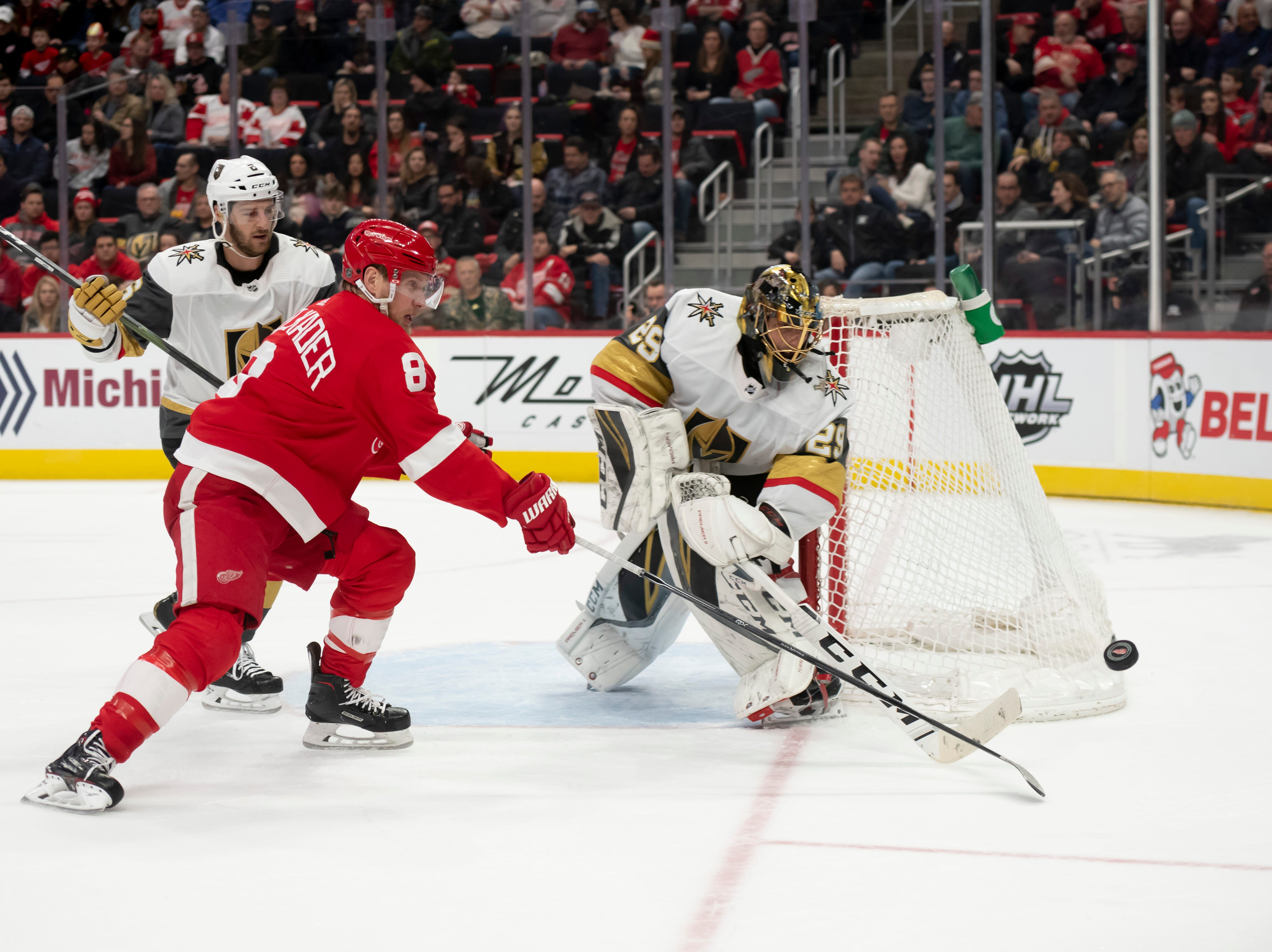 Vegas goaltender Marc-Andre Fleury flicks the puck away from Detroit left wing Justin Abdelkader  in the first period.
