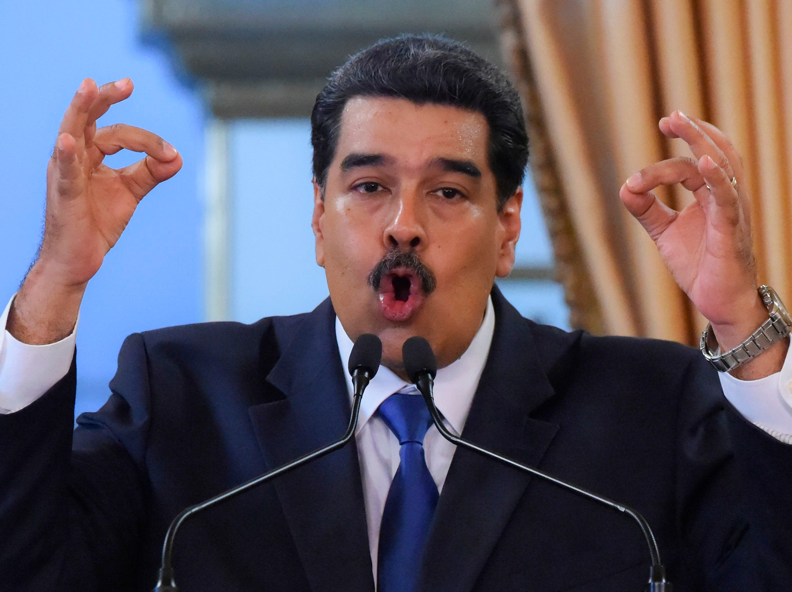 """Venezuelan President Nicolas Maduro delivers a speech in Caracas on February 8, 2018. - Venezuelan President Nicolas Maduro vowed on Friday not to let in """"fake"""" aid from the United States requested by opposition leader Juan Guaido, which is being stockpiled at the border with Colombia."""