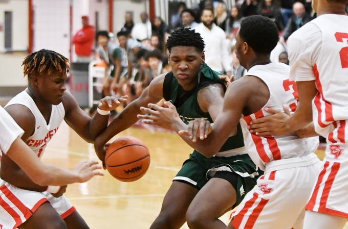 Chippewa Valley's Myren Harris, left, and Corey McCray, right, guard New Haven's Romeo Weems in the first half.    Chippewa Valley loses 66-52 to New Haven at Chippewa Valley High School in Clinton Township, Mich. on Feb. 7, 2019.
