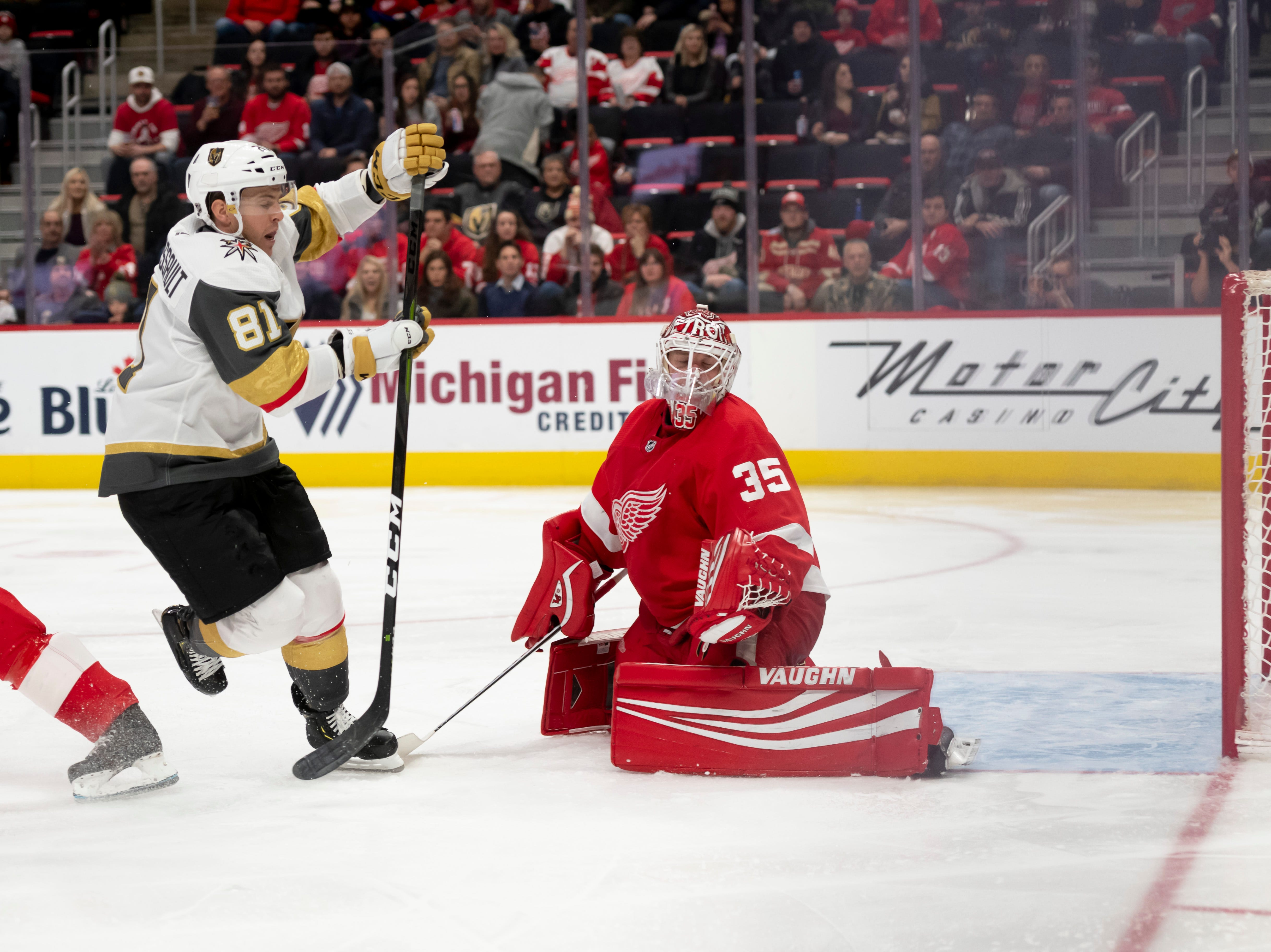 Vegas center Jonathan Marchessault sends the puck past Detroit goaltender Jimmy Howard for a goal in the second period.    Marchssault scored twice in the period.