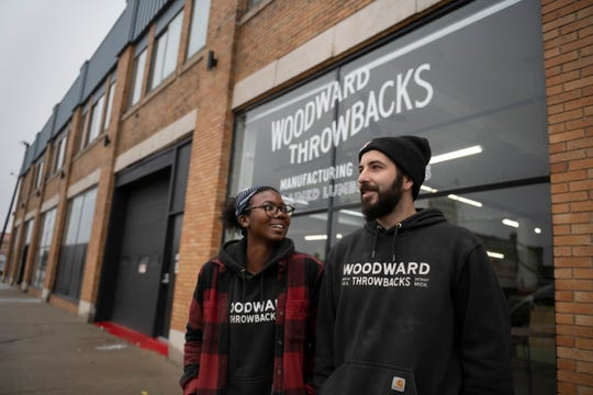Bo Shepherd, left, and Kyle Dubay, co-owners of Woodward Throwbacks, outside their store in Hamtramck.  The 24,000-square-foot former car dealership had sat empty for about a decade before they bought it in 2016.