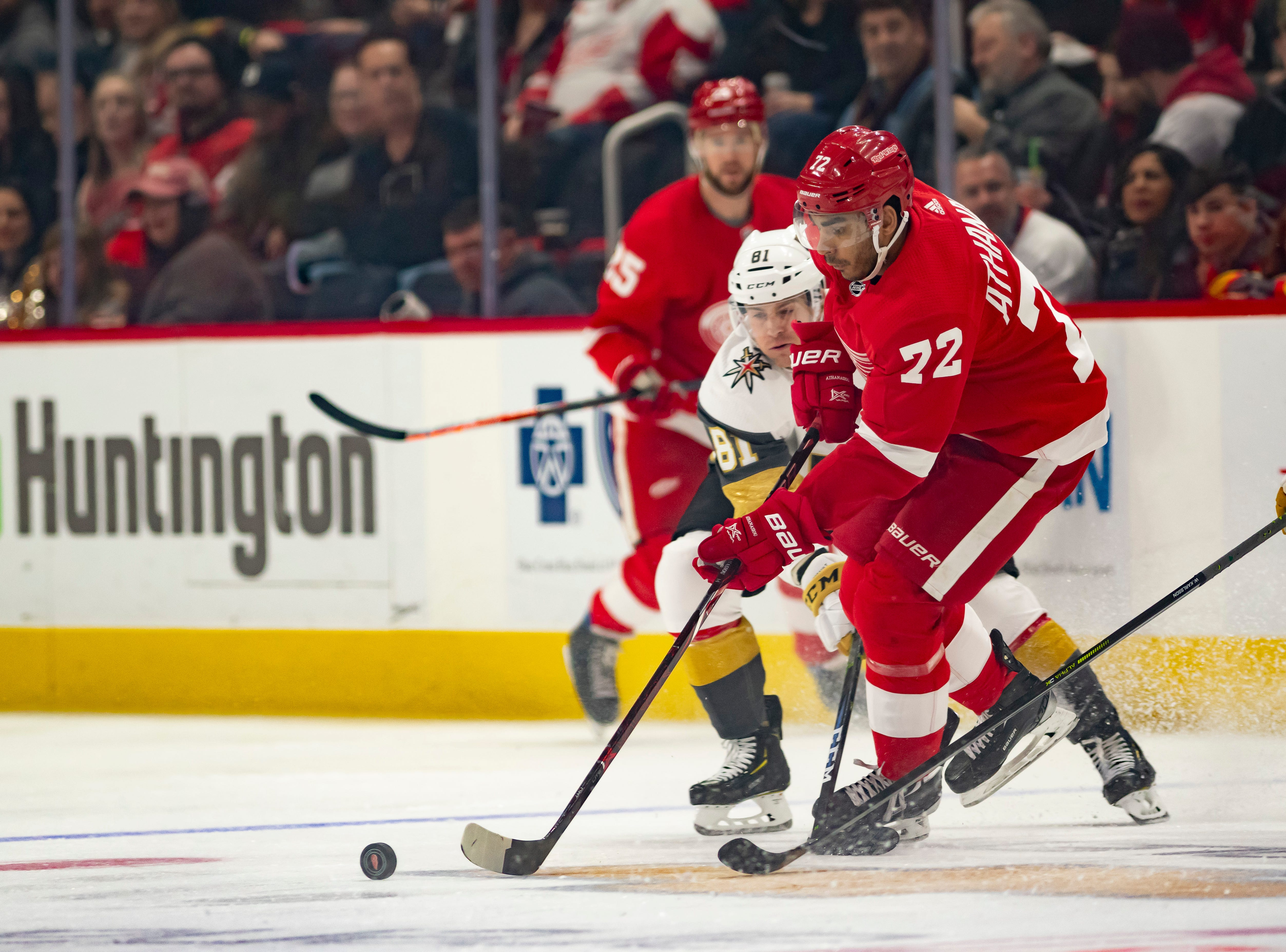 Detroit center Andreas Athanasiou keeps the puck away from Vegas center Jonathan Marchessault in the first period.