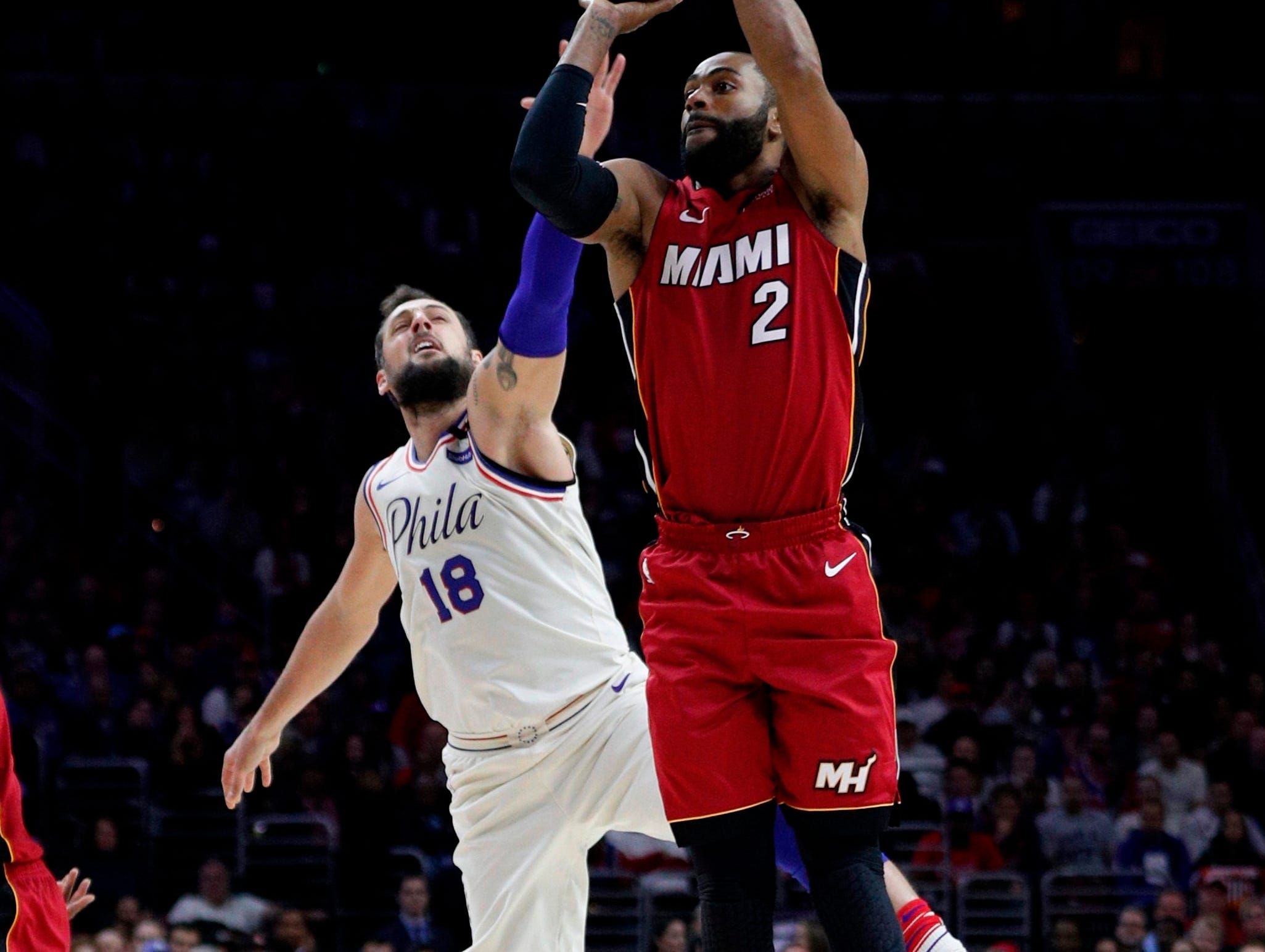 Miami Heat's Wayne Ellington shoots with Philadelphia 76ers' Marco Belinelli defending during the first half in Game 2 of a first-round NBA basketball playoff series, Monday, April 16, 2018, in Philadelphia.