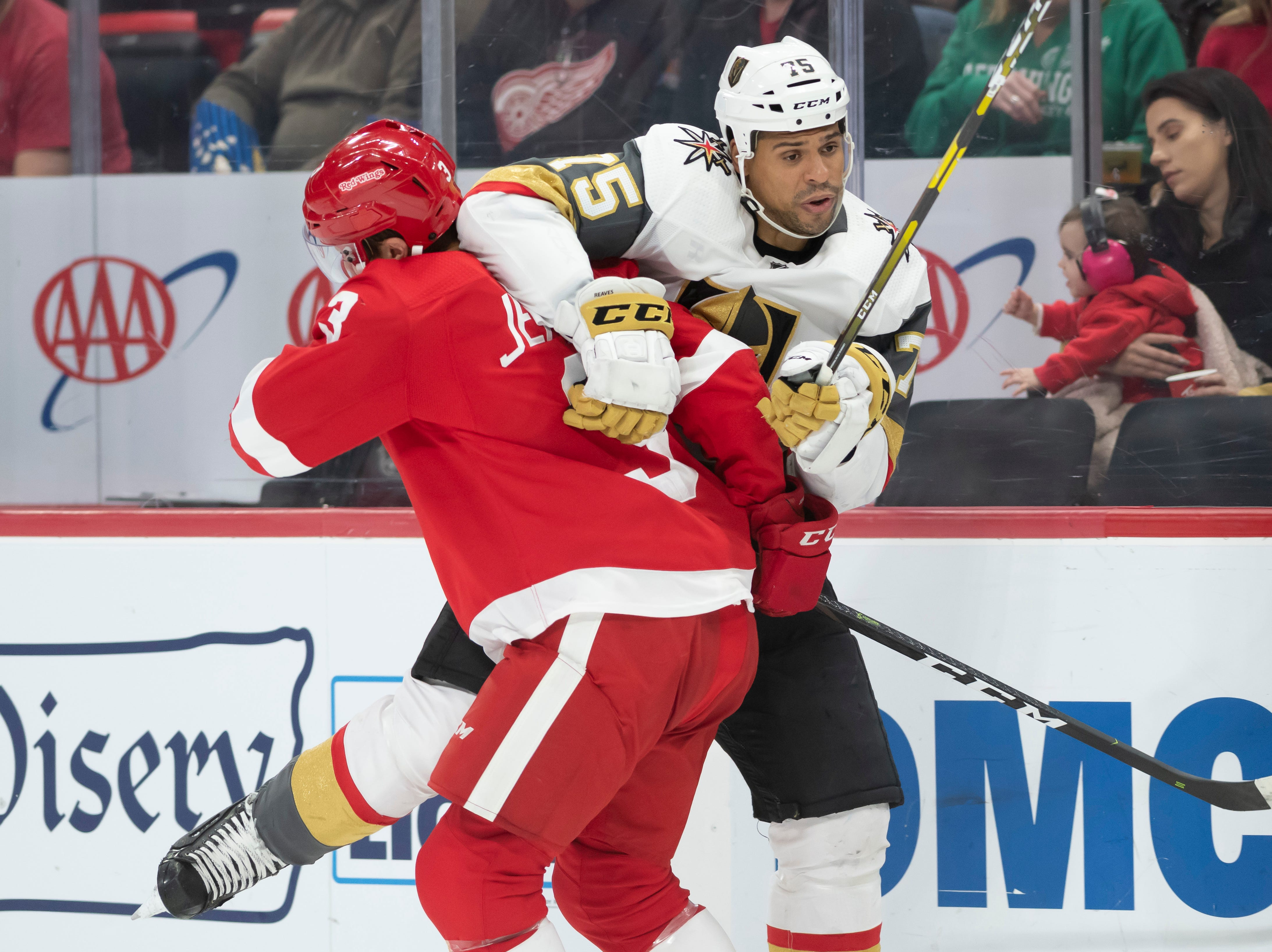 Detroit defenseman Nick Jensen and Vegas right wing Ryan Reaves get tangled up in the second period.
