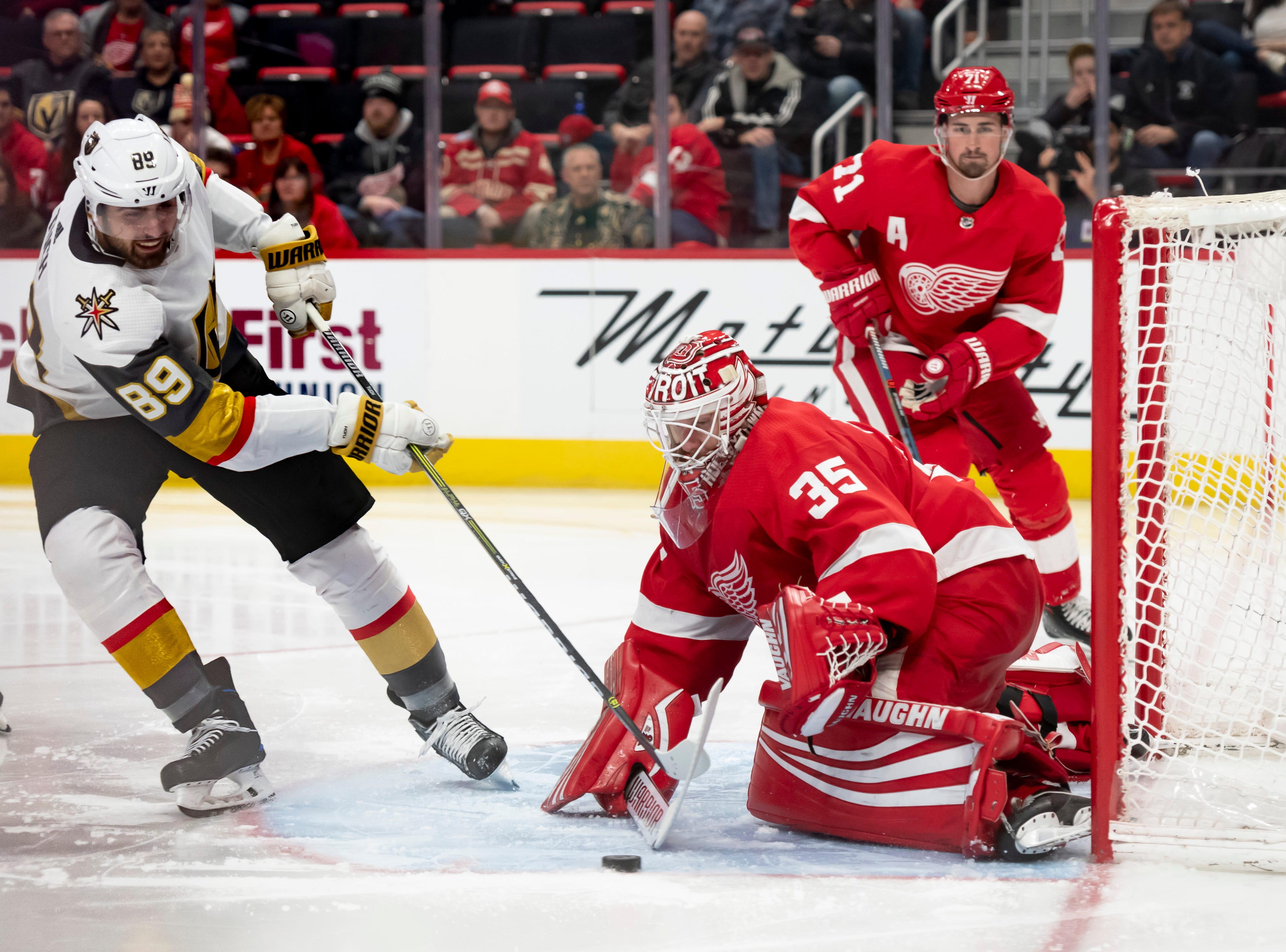 Vegas right wing Alex Tuch tries to get the puck past Detroit goaltender Jimmy Howard in the second period.