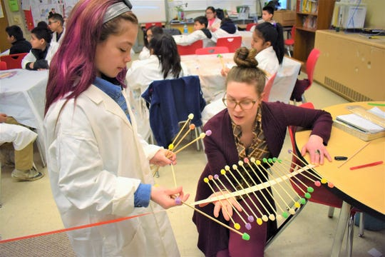 Living Arts teaching artist Stephanie Howells uses kinetic sculpture to illustrate the properties of waves and energy at Cesar Chavez Academy.