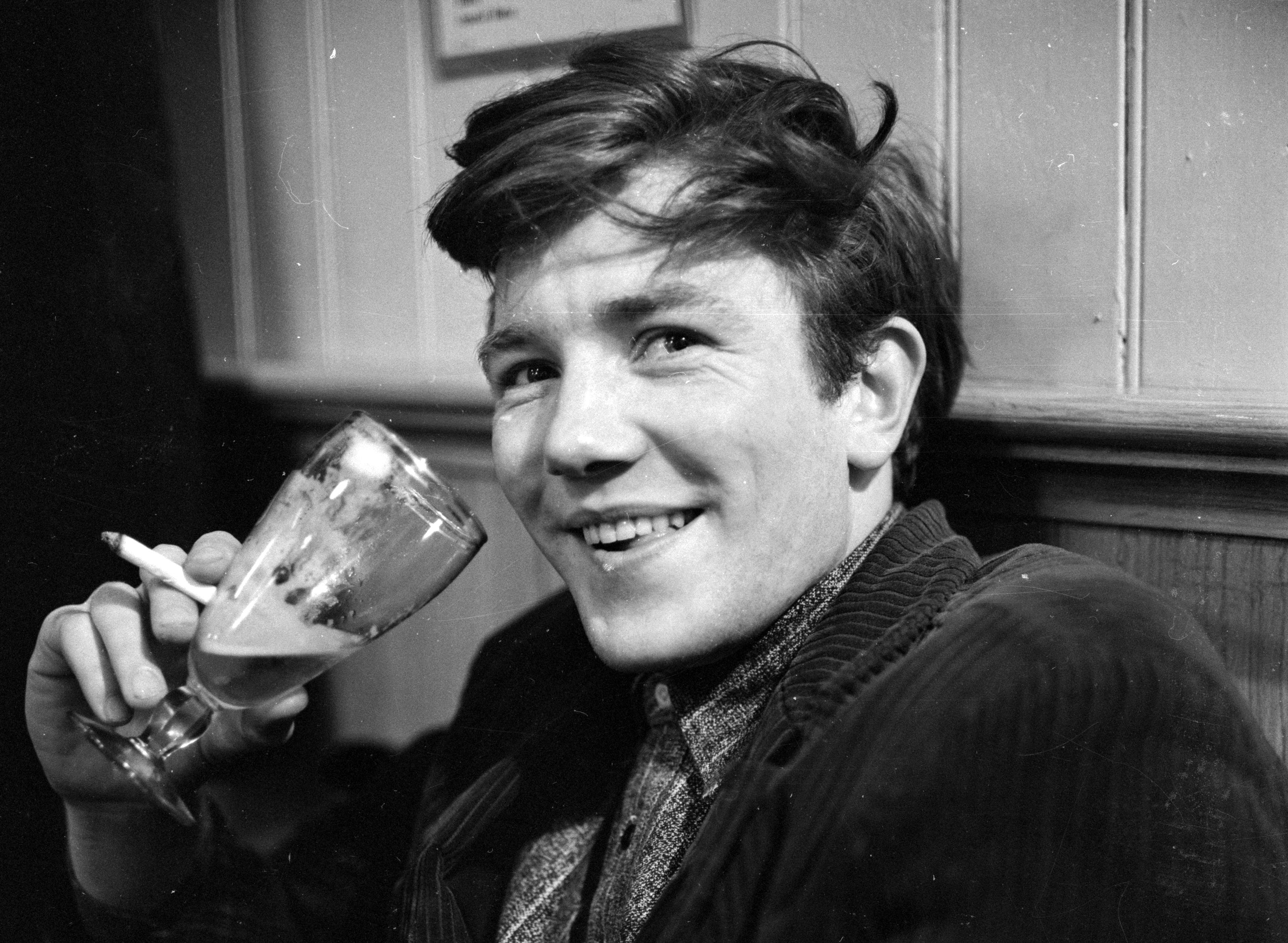 February 1961:  British film and stage actor Albert Finney enjoying a glass of beer in his regular pub behind the Cambridge Theatre in London.