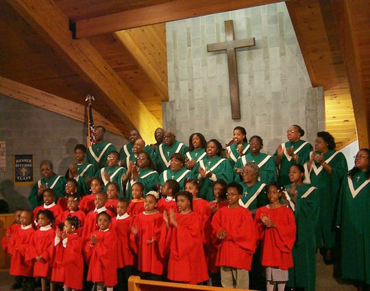 The combined adult and children's choirs at Friendship Baptist Church in Corning rehearse in this file photo.