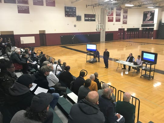 Faculty and staff gathers Thursday to ask questions of DOH officials