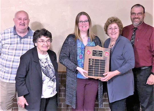 Helene Rouse, Hall Award winner for 2017, presents the Hall Award for 2018 to Kirby Band member Amanda Smith, of Waverly. From left are conductor Donald Van Scoy; Pat Ronsvalle, daughter of Irving and Kathryn Hall; Smith; Rouse; and Kirby Band President Jon Allen.