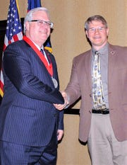 State Sen. Tom O'Mara, left, accepts the American Red Cross Legislator of the Year Award from Red Cross/Finger Lakes Chapter Executive Director Brian McConnell.