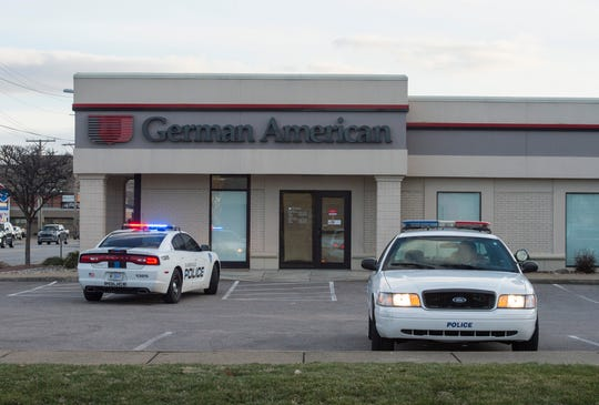 The Evansville Police Department investigate a robbery of a German American Bank branch at 530 N. St. Joseph Ave. Friday, Feb. 8, 2019.