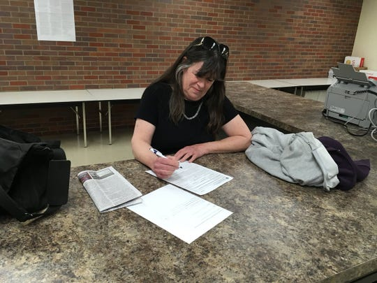 Connie Whitman fills out paperwork to enter the May 7 Republican primary for Evansville mayor.