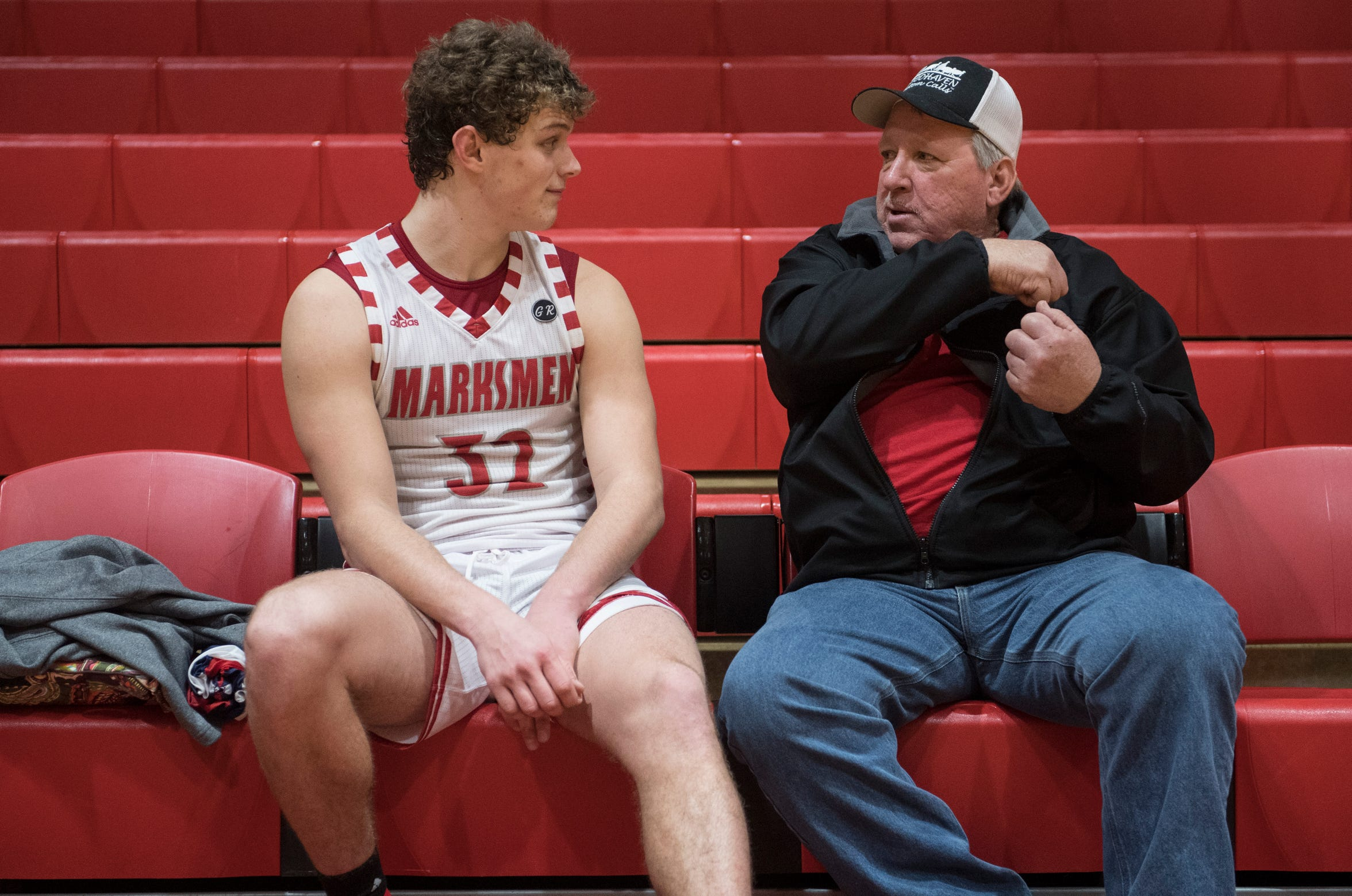 Tell City's Braeden Beard (32) talk to his grandfather Kenny Deom after the Tell City vs Gibson Southern game Thursday, Feb. 7, 2019.