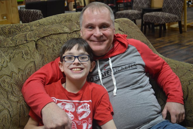Mark Jennings, right, became Gavin Amato's mentor through Community Youth Mentoring. The relationship between Jennings and Amato's family blossomed, and he is now Amato's godfather.
