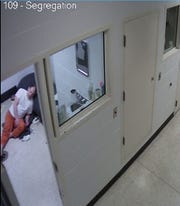 Daniel Myers, slumped over in his jail cell after a health emergency Oct. 15.