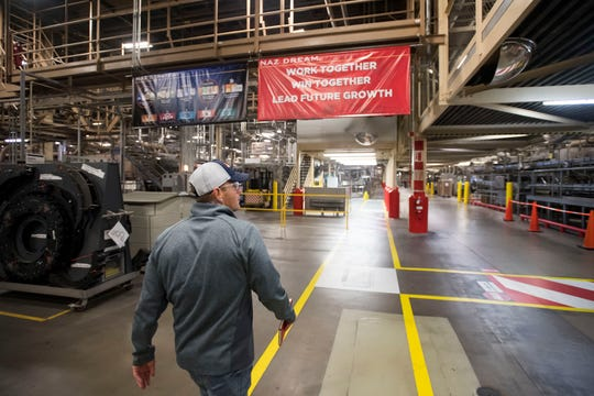 General Manager Gene Bocis leads a tour through the bottling floor on Wednesday, Feb. 6, 2019, at the Anheuser Busch brewery in Fort Collins, Colo.