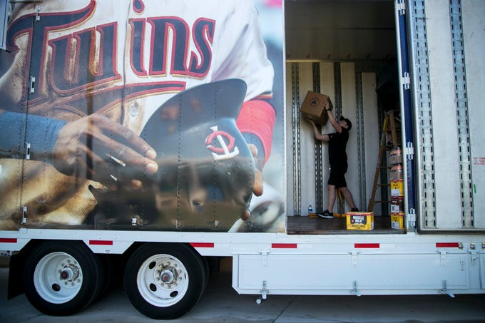 Austin Cozad helps unload the truck filled with gear for the Minnesota Twins on Friday, Feb. 8, 2019, at the Century Link Sports Complex in Fort Myers.