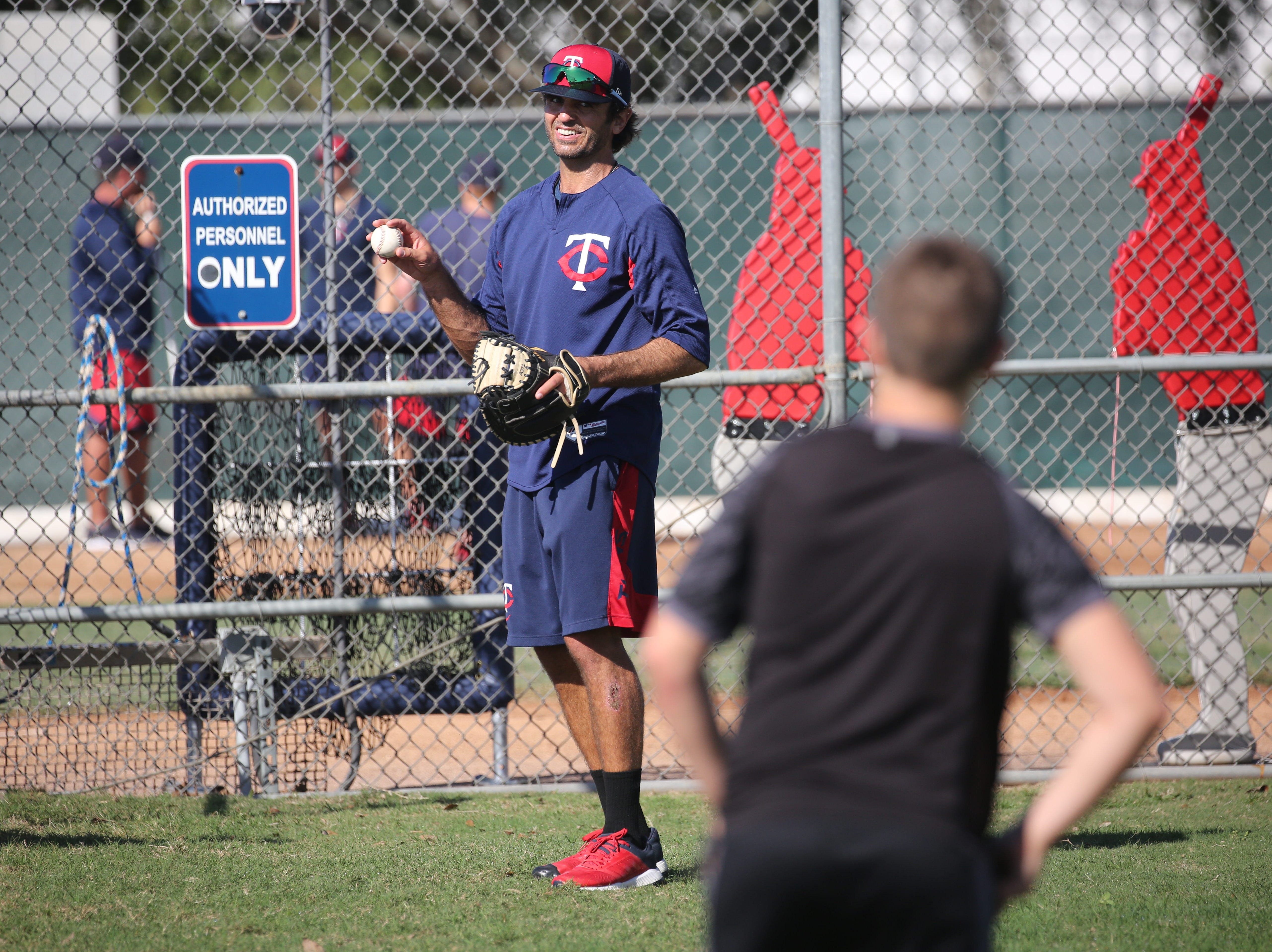 Virgil Vasquez, a pitching coach for the Minnesota Twins organization, throws with Twins fan Thomas Slette, 12, of Hawley, Minn., on Friday morning, Feb. 8, 2019, at the Century Link Sports Complex in Fort Myers. The first official Spring Training practice for pitchers and catchers is on Wednesday.
