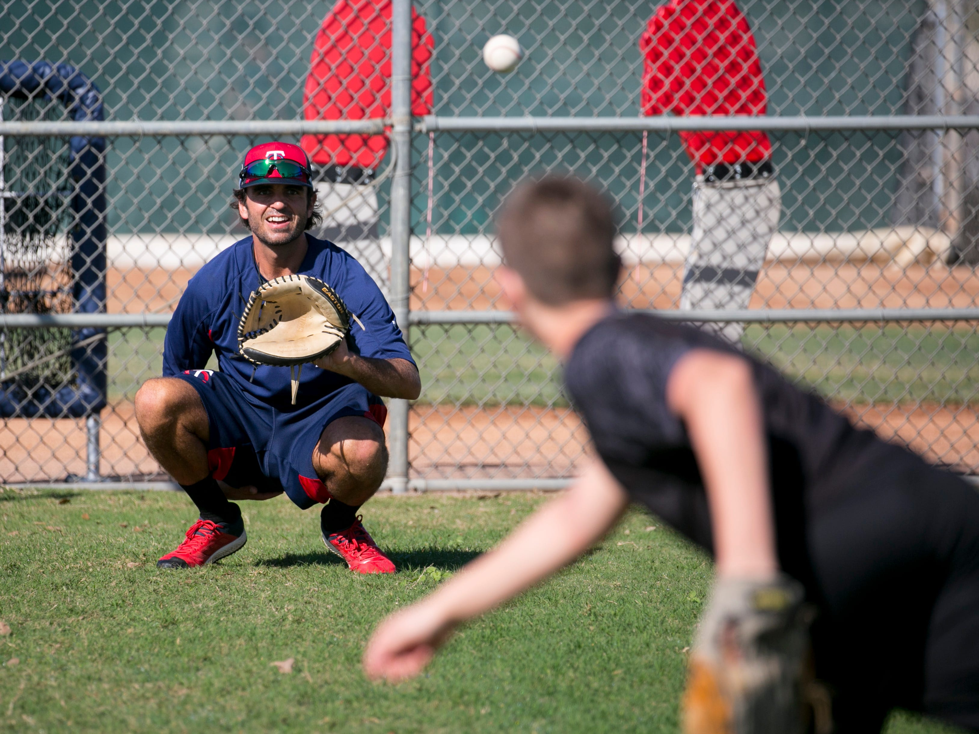 Virgil Vasquez, a pitching coach for the Minnesota Twins organization, catches a pitch from Thomas Slette, 12, of Hawley, Minn., on Friday morning, Feb. 8, 2019, at the Century Link Sports Complex in Fort Myers. The first official Spring Training practice for pitchers and catchers is on Wednesday.