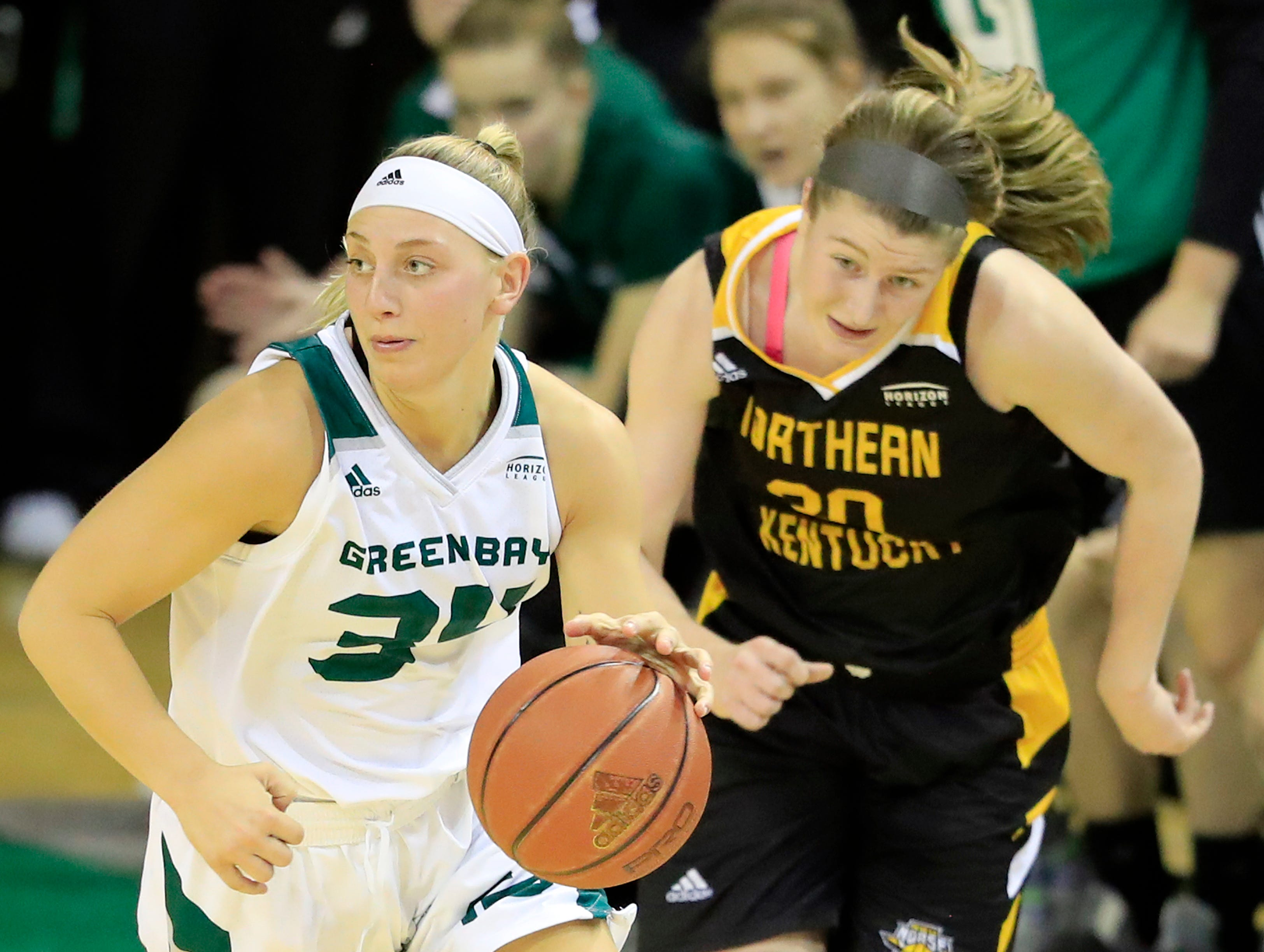 Green Bay Phoenix forward Carly Mohns (34) dribbles away from Northern Kentucky Norse forward/center Emmy Souder (30) in a Horizon League women's basketball game at the Kress Center on Thursday, February 7, 2019 in Green Bay, Wis.