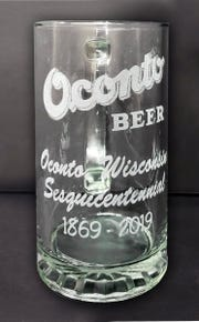 An eteched beer mug being sold by the Oconto County Historical Society to mark the City of Oconto's 150th anniversary in 2019.