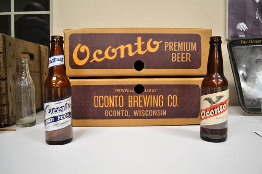 Oconto brand beer bottles from decades, along with a carton from the factor, are part of the collection of brewery items owned by Pete Stark, president of the Oconto County HIstorical Society. OCHS is working on getting an Oconto-labeled brew for the city's sesquicentennial this year.