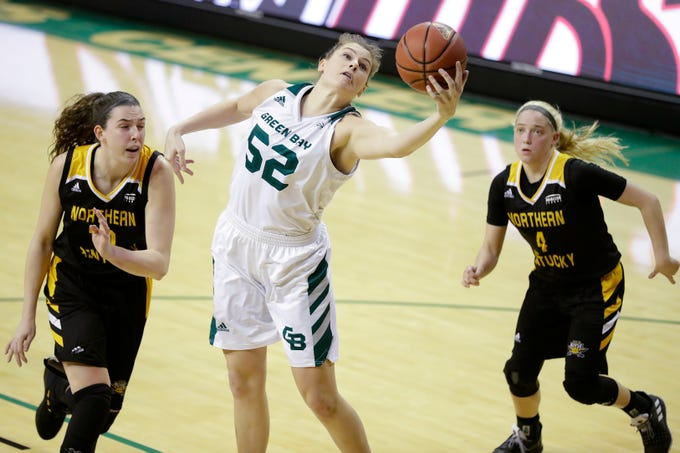 Green Bay Phoenix forward/center Madison Wolf (52) catches a ball under the basket against the Northern Kentucky Norse in a Horizon League women's basketball game at the Kress Center on Thursday, February 7, 2019 in Green Bay, Wis.