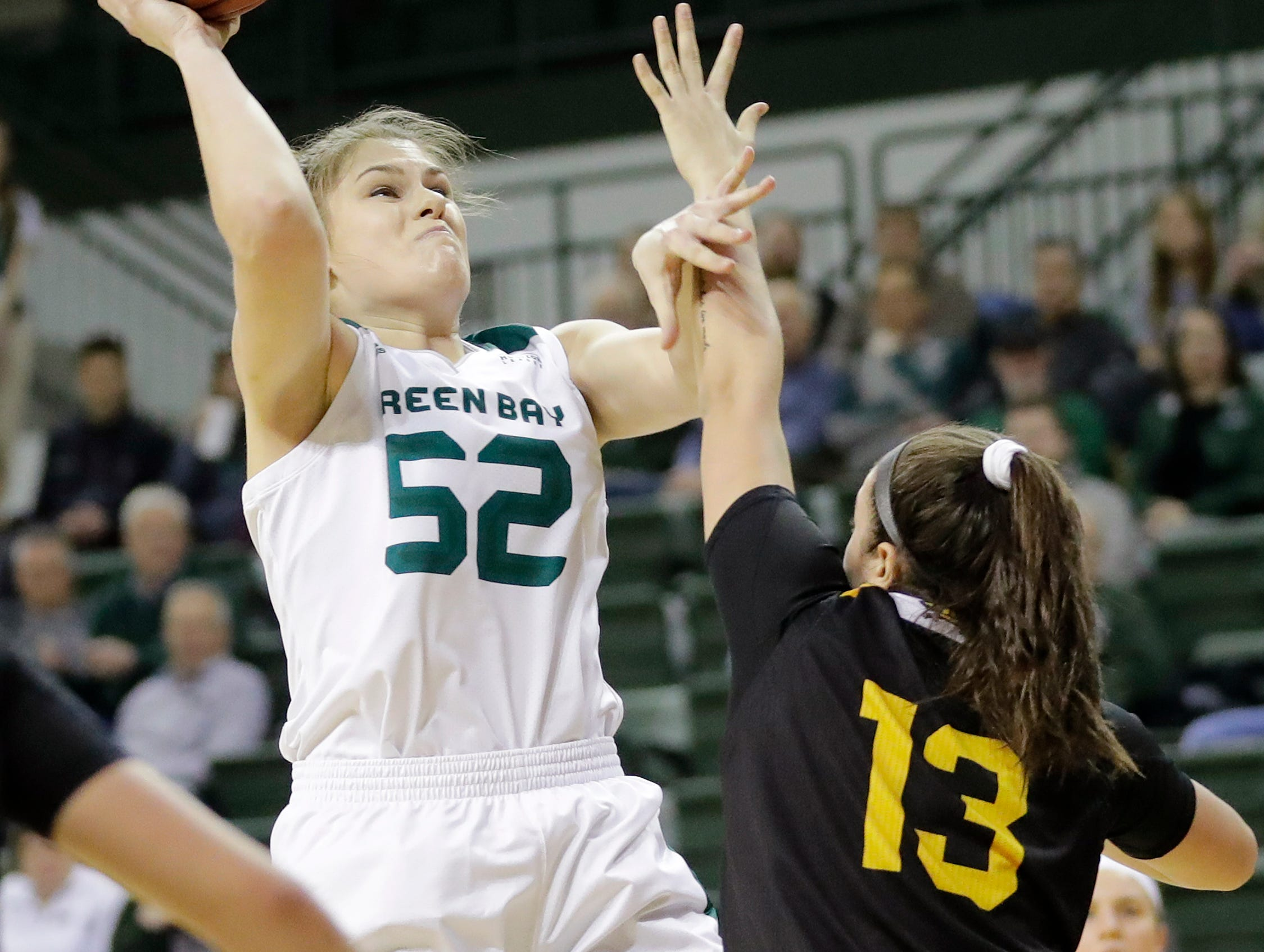 Green Bay Phoenix forward/center Madison Wolf (52) shoots over Northern Kentucky Norse forward Jazmyne Geist (13) in a Horizon League women's basketball game at the Kress Center on Thursday, February 7, 2019 in Green Bay, Wis.