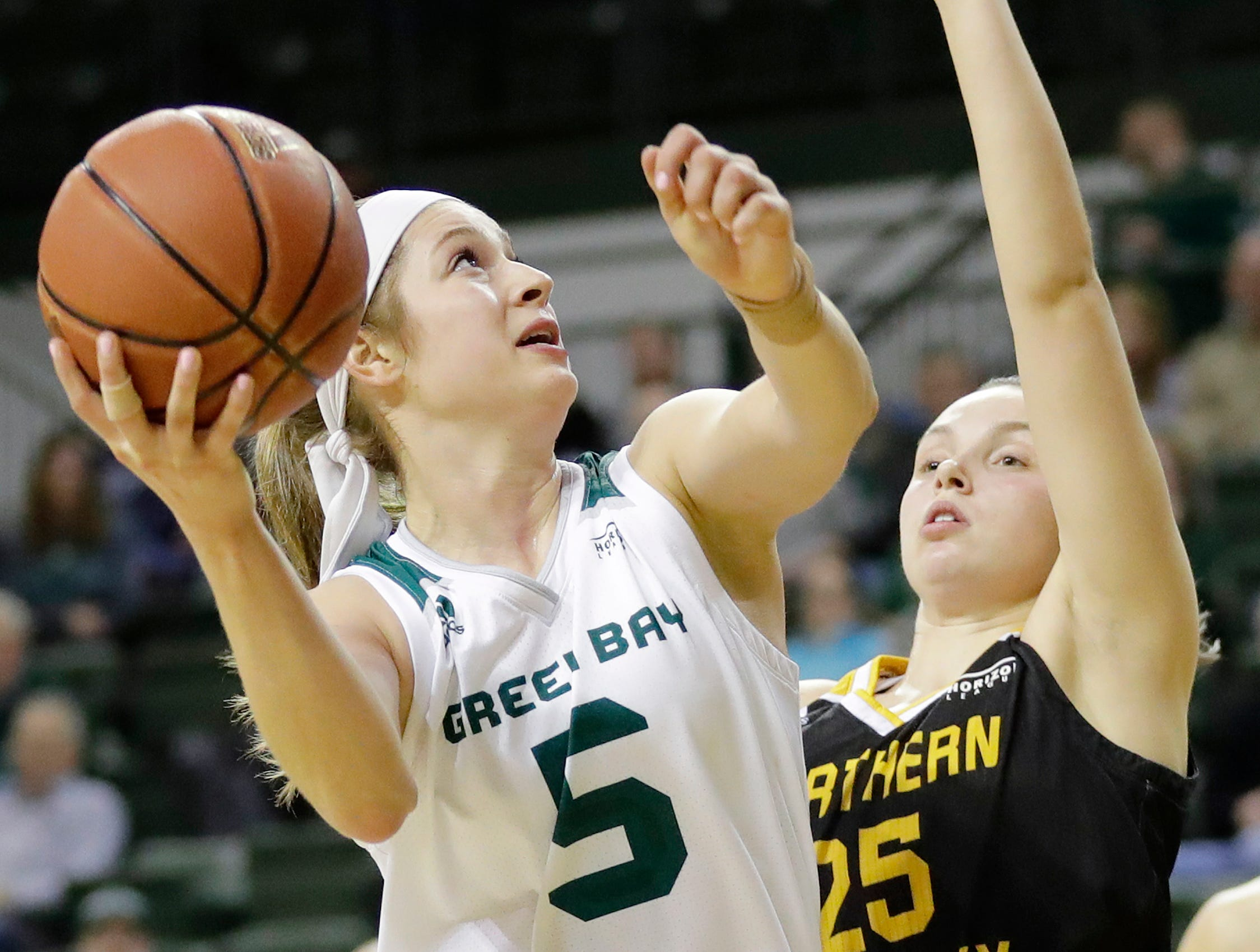 Green Bay Phoenix guard Laken James (5) shoots past Northern Kentucky Norse guard Ally Niece (25) in a Horizon League women's basketball game at the Kress Center on Thursday, February 7, 2019 in Green Bay, Wis.