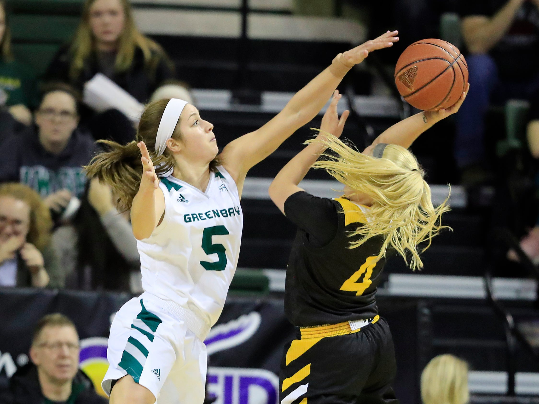 Green Bay Phoenix guard Laken James (5) defends a shot by Northern Kentucky Norse guard Taylor Clos (4) in a Horizon League women's basketball game at the Kress Center on Thursday, February 7, 2019 in Green Bay, Wis.
