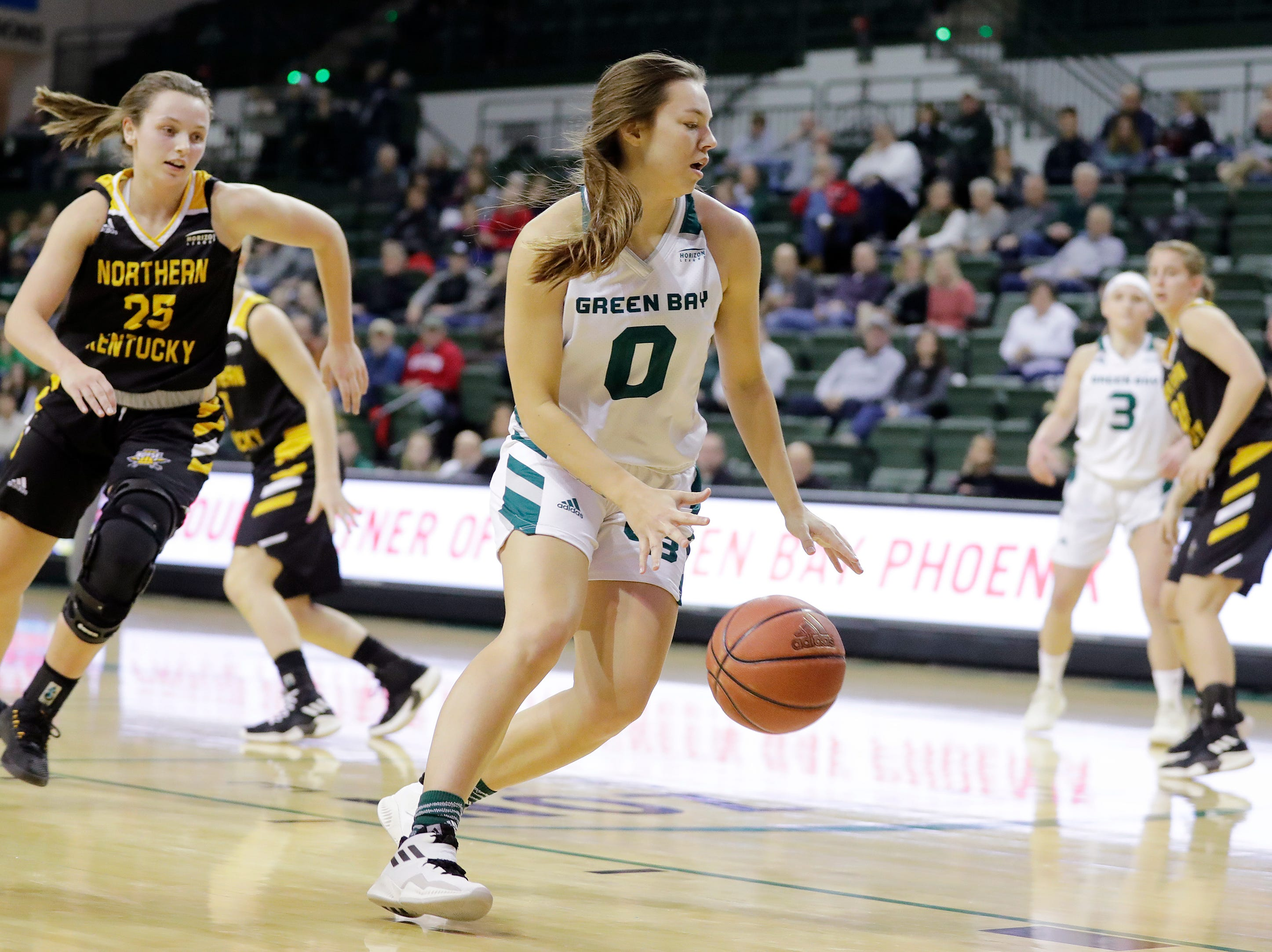 Green Bay Phoenix guard Hailey Oskey (0) dribbles against the Northern Kentucky Norse in a Horizon League women's basketball game at the Kress Center on Thursday, February 7, 2019 in Green Bay, Wis.