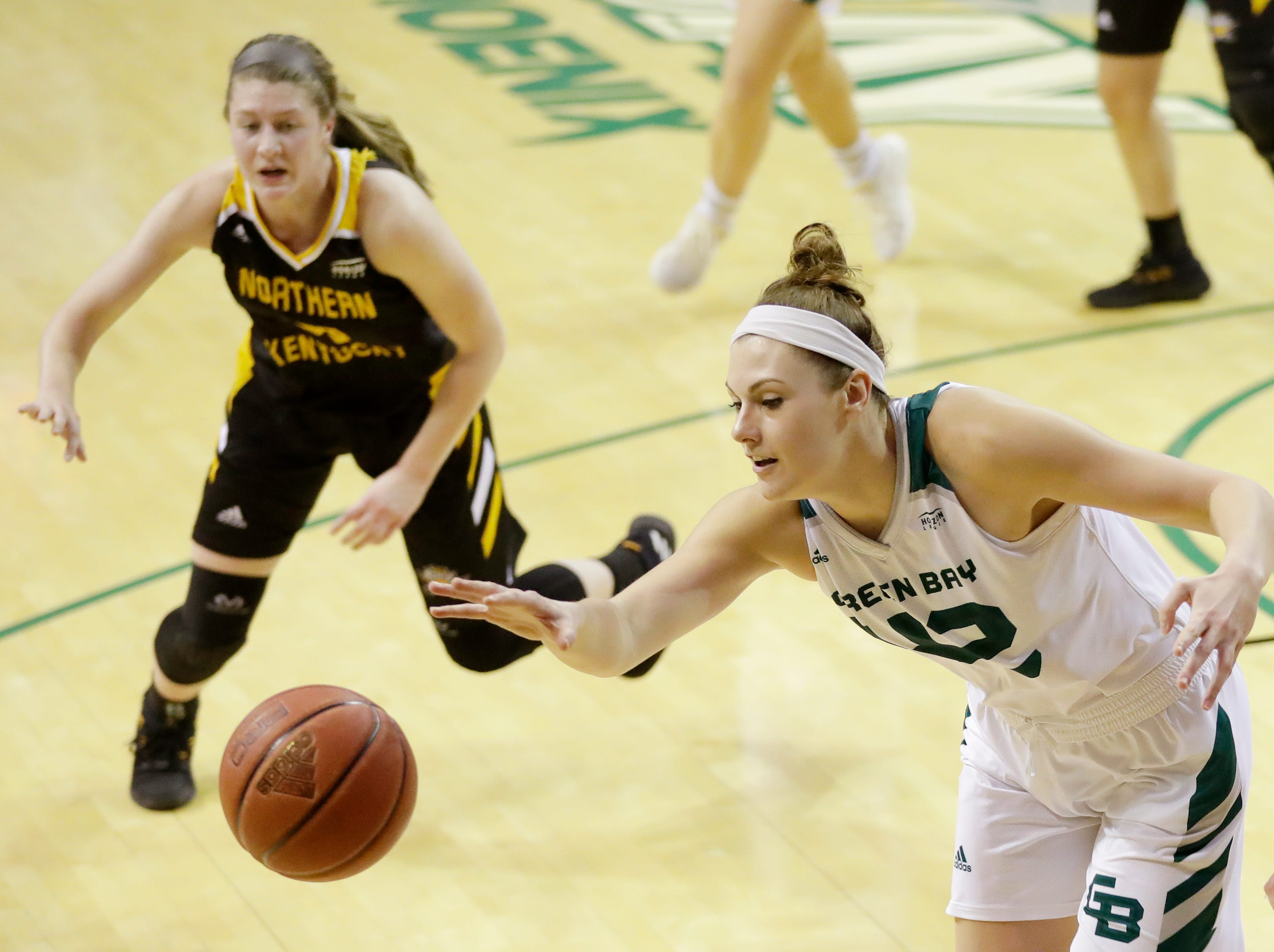 Green Bay Phoenix forward/center Mackenzie Wolf (42) gets to a loose ball against the Northern Kentucky Norse in a Horizon League women's basketball game at the Kress Center on Thursday, February 7, 2019 in Green Bay, Wis.