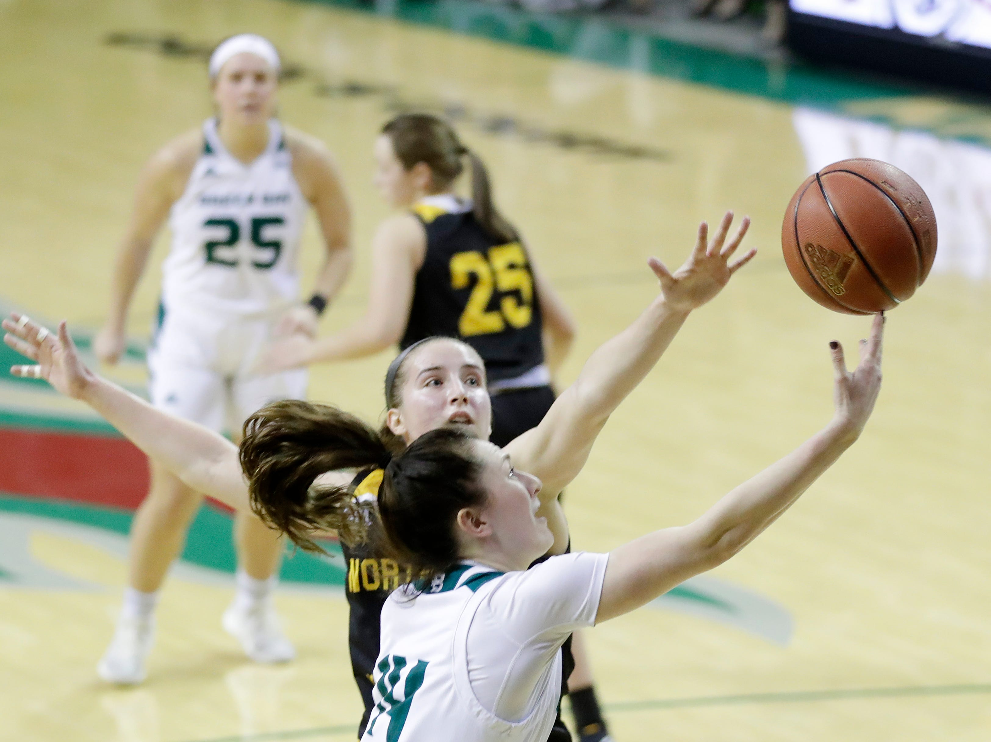 Green Bay Phoenix guard Meghan Pingel (14) shoots against Northern Kentucky Norse forward Kailey Coffey (23) in a Horizon League women's basketball game at the Kress Center on Thursday, February 7, 2019 in Green Bay, Wis.