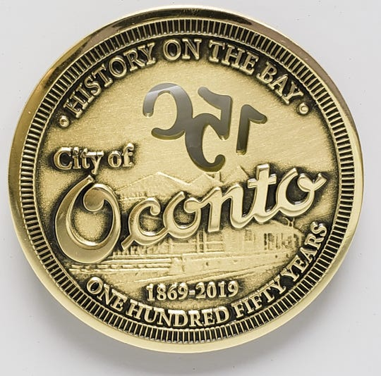 The reverse side of a commemorative coin produced for the City of Oconto's 150th anniversary this year.