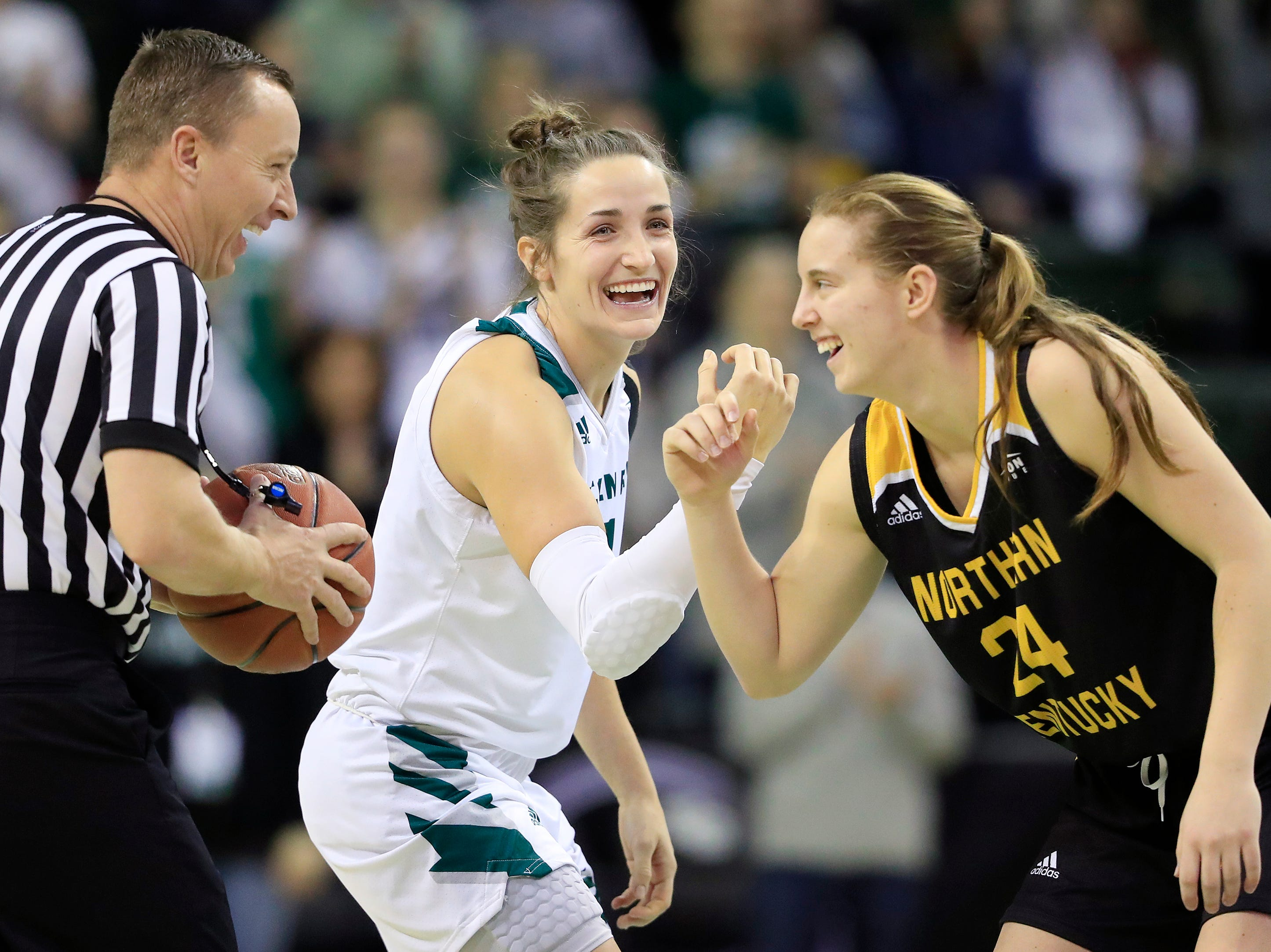 Green Bay Phoenix guard Jen Wellnitz (1) and Northern Kentucky Norse guard Molly Glick (24) joke with the referee before the opening tip of a Horizon League women's basketball game at the Kress Center on Thursday, February 7, 2019 in Green Bay, Wis.