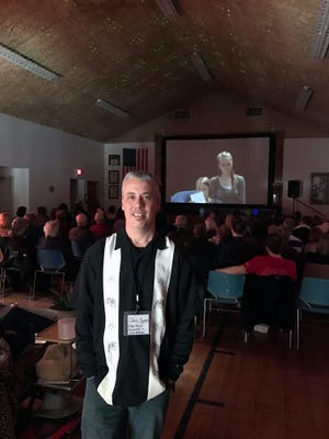 Door County Short Film Fest founder and Executive Director Chris Opper, with a screening taking place in Sister Bay Village Hall at last year's festival.
